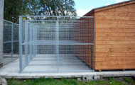 Kennel Runs attached to a wooden outbuilding.